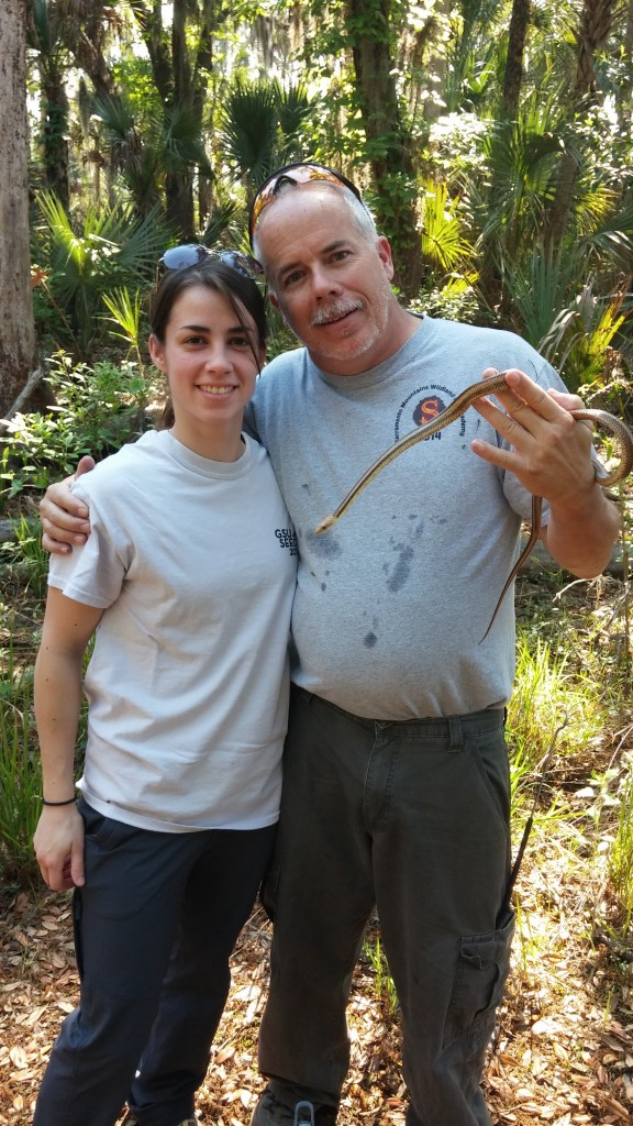 Ron and Alexa smile for a photo with an Eastern Ratsnake (Pantherophis allagheniensis).
